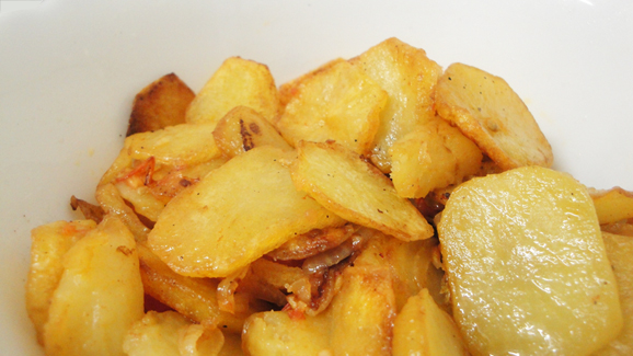 Fried Potato Rings With Onion And Tomato